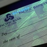 Photo of Printed Cheque Showing Security Features UV Fluorescing